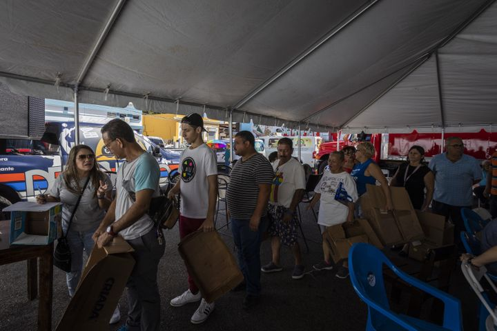 People line up to receive supplies after a 6.4-magnitude earthquake hit Guayanilla, Puerto Rico, on Jan. 11, 2020.