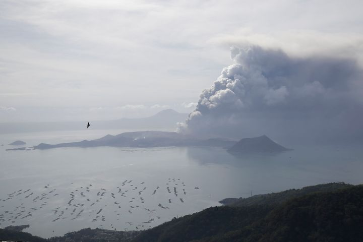 Taal volcano continues to spew ash on Monday Jan. 13, 2020, in Tagaytay, Cavite province, south of Manila, Philippines. Red-h