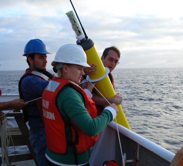 This photo provided by NOAA Corps shows an Argo float being deployed to capture ocean temperature