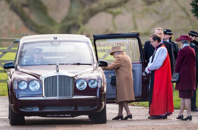 Britain's Queen Elizabeth II leaves after attending a morning church service at St Mary Magdalene Church...