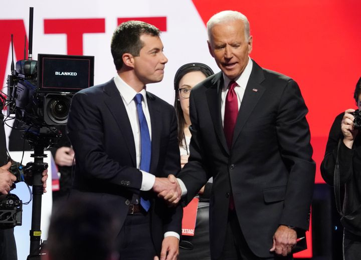 Former South Bend, Indiana, Mayor Pete Buttigieg, left, shakes hands with former Vice President Joe Biden after the Democrati