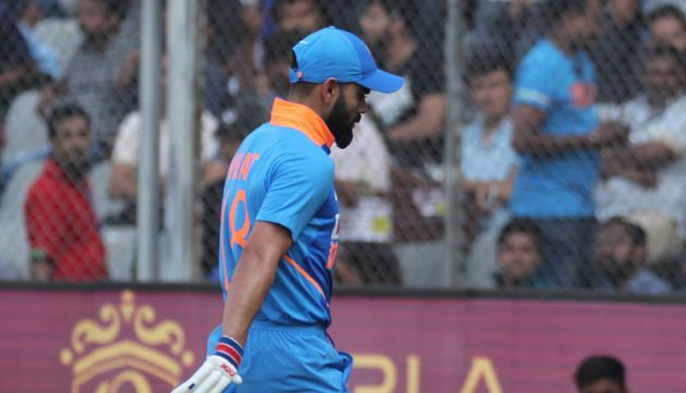 Virat Kohli walks back after losing his wicket during the first one-day international match between India...