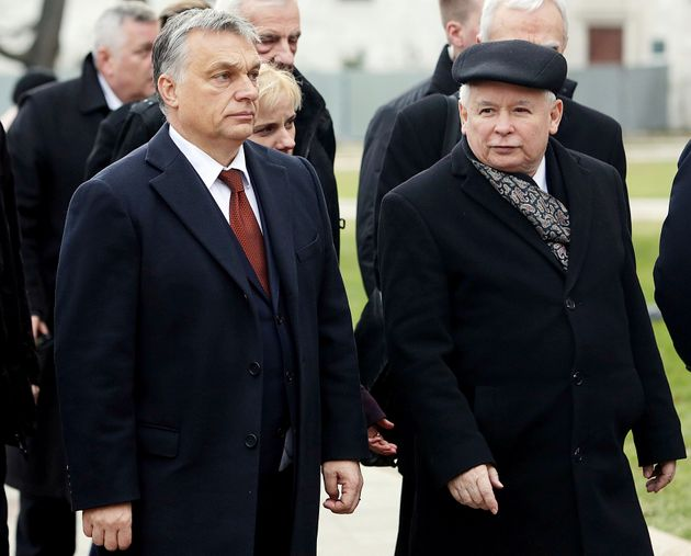 Hungary's Prime Minister Viktor Orban, left, and head of Poland's ruling conservative Law and Justice...