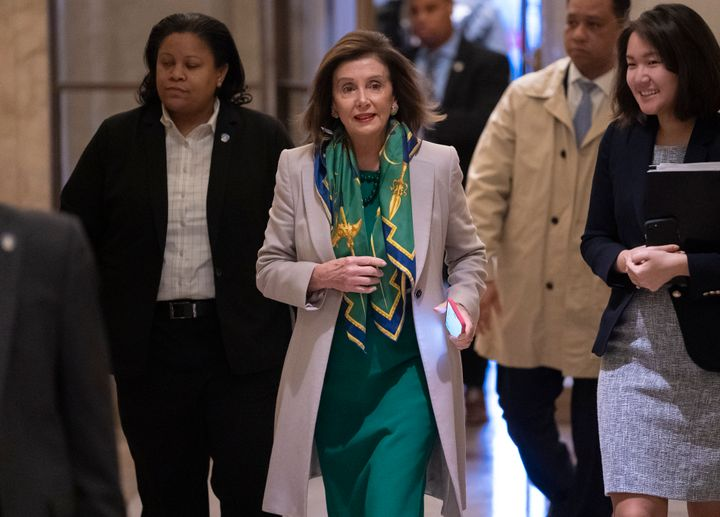 Speaker of the House Nancy Pelosi, D-Calif., arrives to meet with the Democratic Caucus at the Capitol in Washington on Tuesd