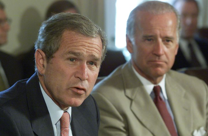 Then-Sen. Joe Biden (D-Del.), right, supported deposing Iraqi leader Saddam Hussein in 2003 while George W. Bush was presiden