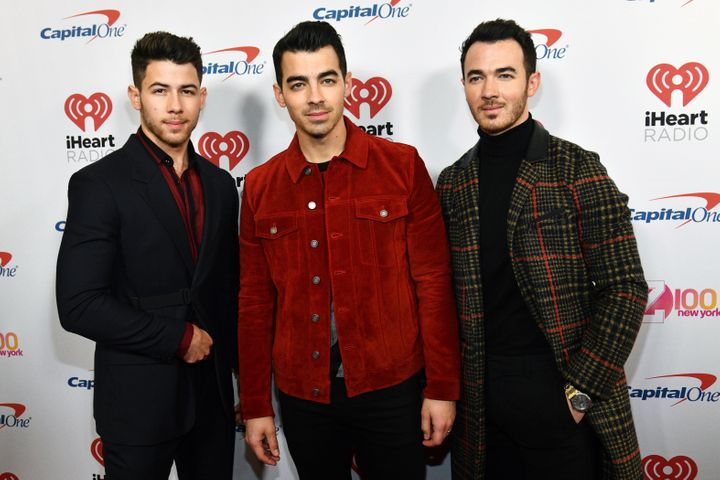 Nick Jonas, Joe Jonas and Kevin Jonas attend Z100's iHeartRadio Jingle Ball in New York City.