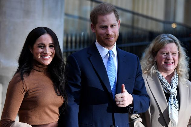 The Duke and Duchess of Sussex stand with High Commissioner for Canada in the United Kingdom Janice Charette...
