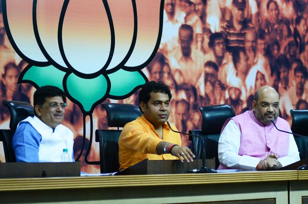 HuffPost India spoke with Shrikant Sharma (centre), a cabinet minister and spokesperson of the BJP government...