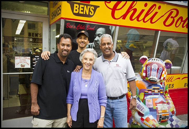 Virginia Ali (center) with family celebrating the 60th anniversary of Ben's Chili Bowl in 2018.