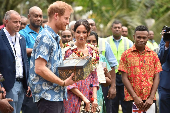 The royal couple receive a gift from the University of the South Pacific after Meghan recounts her own struggles to afford her university degree.