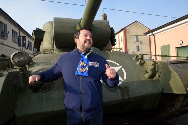 League's leader Matteo Salvini poses next to a tank that was used in an old fiction movie during an electoral...