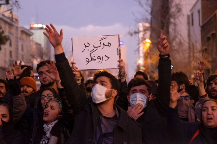 A protester holds a sign that reads, Death To The Liar, during a vigil for the victims of the Ukraine Boeing 737 plane crash in Tehran on Jan. 11, 2020.