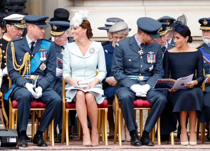 Prince William, Duke of Cambridge; Catherine, Duchess of Cambridge; Prince Harry, Duke of Sussex and Meghan, Duchess of Sussex attend a ceremony to mark the centenary of the Royal Air Force on the forecourt of Buckingham Palace on July 10, 2018, in London, England.