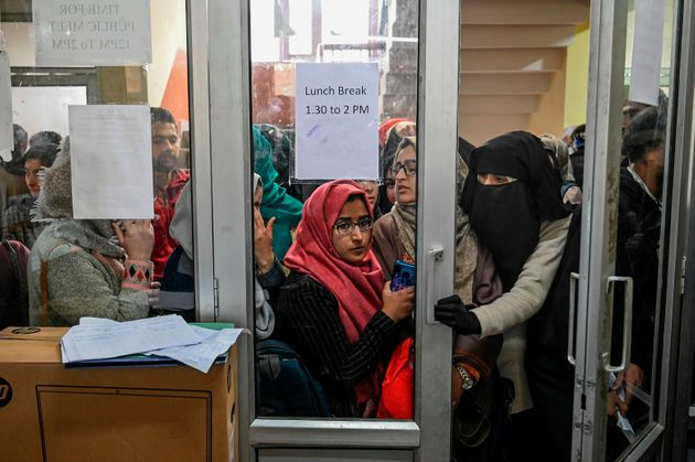 In this photo taken on November 26, 2019, Kashmiri students wait for their turn to use the internet at...