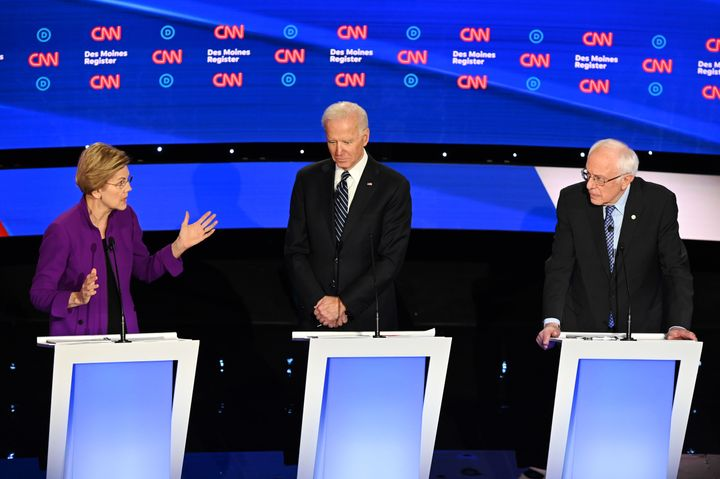 Sen. Elizabeth Warren, former Vice President Joe Biden, and Sen. Bernie Sanders participate in the seventh Democratic primary