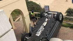 Range Rover Crashes And Flips Onto Iconic Bondi Beach Tourist