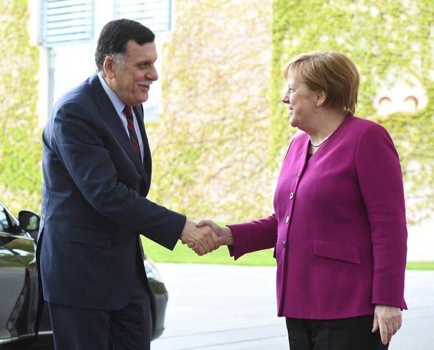 Η Μέρκελ με τον πρόεδρο...