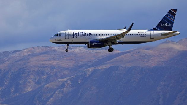 JetBlue's efforts to reduce in-flight waste include a recycling program to sort and recycle bottles and...