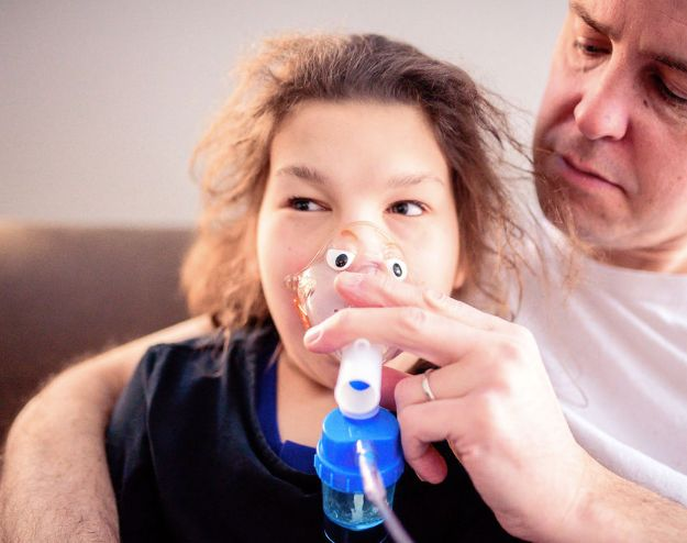 Claire requires multiple medications a day to keep her healthy, including nebulizer treatments to help her breathe.