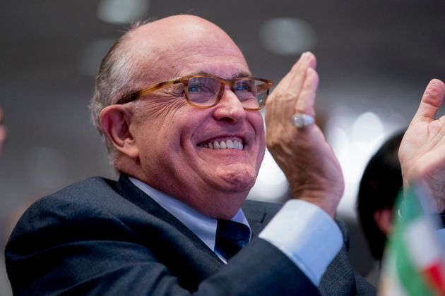 Rudy Giuliani, an attorney for President Donald Trump, applauds at the Iran Freedom Convention for Human...