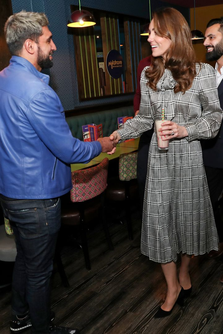 The Duchess of Cambridge meets with Amir Khan during a visit to MyLahore's flagship restaurant.