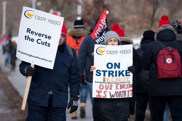 High school teachers picket outside the Bickford Centre in Toronto on Dec. 11,