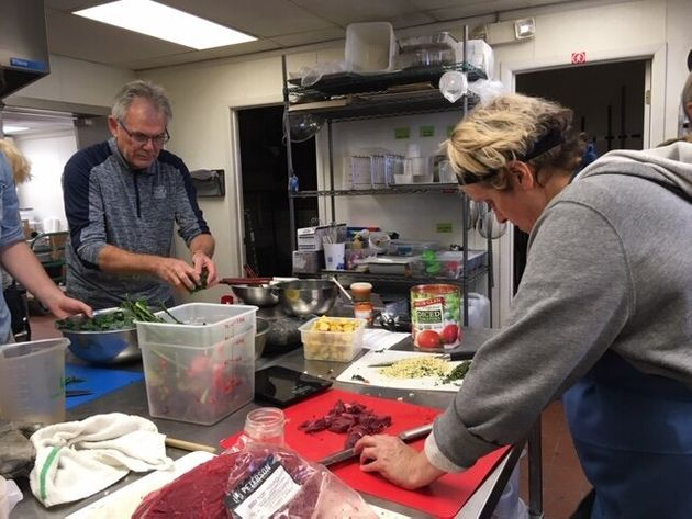 A group participates in a collective cooking party organized by Eat for