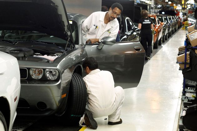 In this Jan. 7, 2011 file photo, employees work on the Chrysler assembly line in Brampton, Ont. A new...
