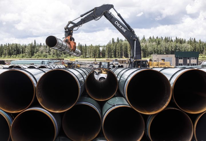 Pipe for the Trans Mountain pipeline expansion are unloaded in Edson, Alta. on June 18, 2019.