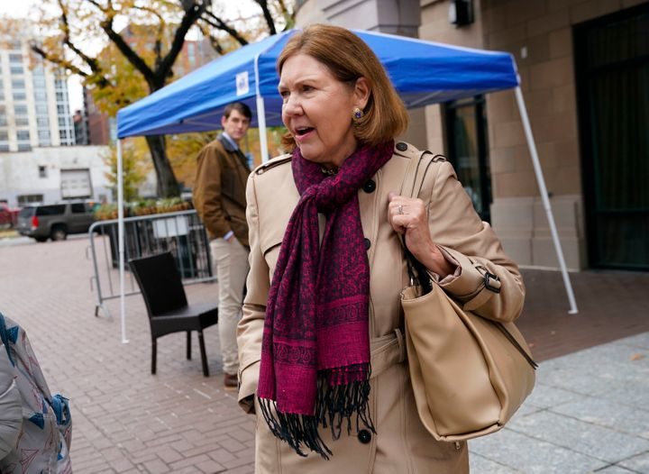 Rep.-elect Ann Kirkpatrick, D-Ariz., walks outside after checking-in for orientation for new members of Congress, Tuesday, No