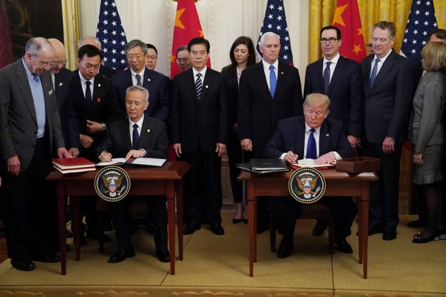 Chinese Vice Premier Liu He and U.S. President Donald Trump sign