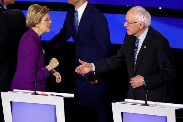 Democratic presidential candidate Sen. Elizabeth Warren, D-Mass., left and Sen. Bernie Sanders, I-Vt....