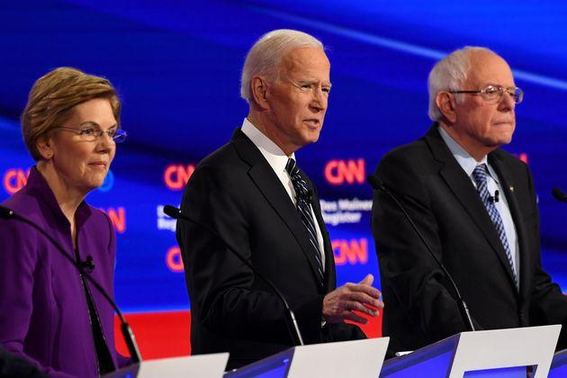 Democratic presidential hopefuls Massachusetts Senator Elizabeth Warren (L), former Vice President Joe...