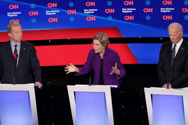 DES MOINES, IOWA - JANUARY 14: TTom Steyer (L) and former Vice President Joe Biden (R) listen as Sen....