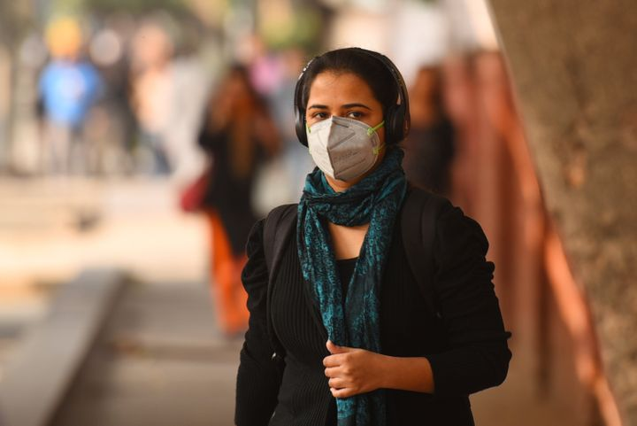 A girl wearing a face mask due to poor air quality in Delhi on November 25, 2019.