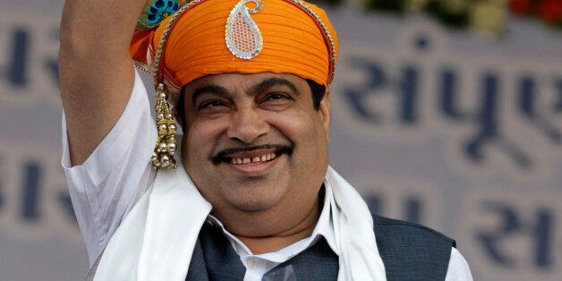 India's main opposition Bharatiya Janata Party (BJP) President Nitin Gadkari waves to the crowd during...