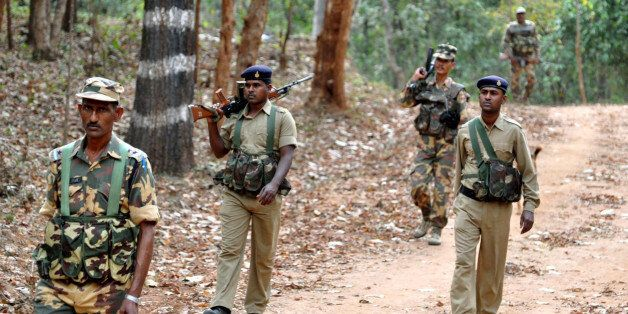 Indian paramilitary soldiers patrol during 'Operation Green Hunt' near the jungles of Lathehar, some...