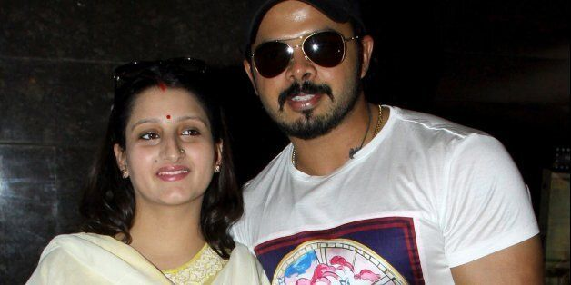 Former Indian cricketer Shanthakumaran Sreesanth (R) and his wife attend the press show of Hindi film...