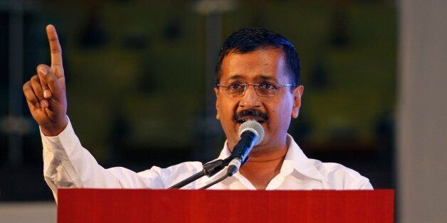 Delhi Chief Minister Arvind Kejriwal addresses a gathering after launching an anti-corruption helpline...