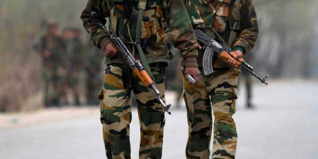 Indian army soldiers arrive at the site of a gunbattle in Srinagar, India, Wednesday, March 13, 2013....