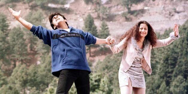 GULMARG, INDIA: Indian actors Amir Khan (L) and Monisha Querrilla perform a dance sequence during the...
