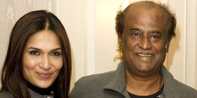 Bollywood director Soundarya (L) and actor Rajinikanth pose on March 31, 2012 in London during the promotion...
