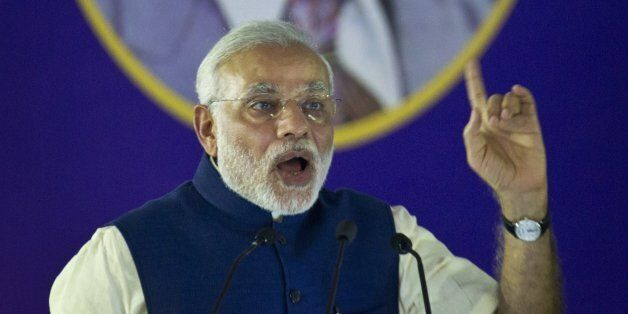 Indian Prime Minister Narendra Modi speaks after unveiling the foundation stone for an international...