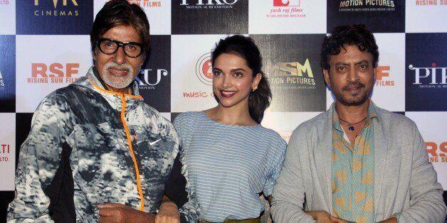 Indian Bollywood actors Amitabh Bachchan (L), Deepika Padukone (C) and Irrfan Khan pose for a photograph...