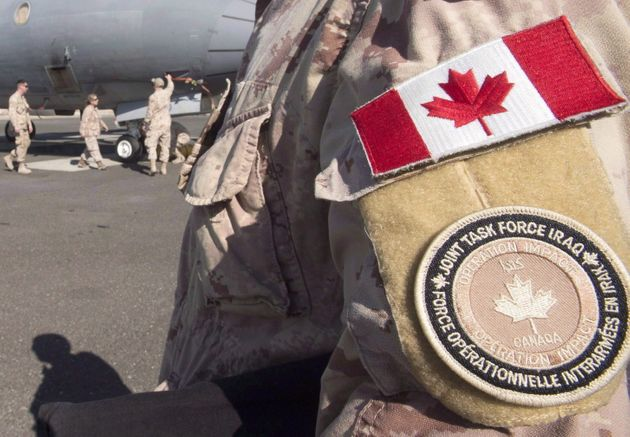 A member of the Canadian Forces stands on a tarmac in the Persian Gulf in February 2017. Canadian aircraft...