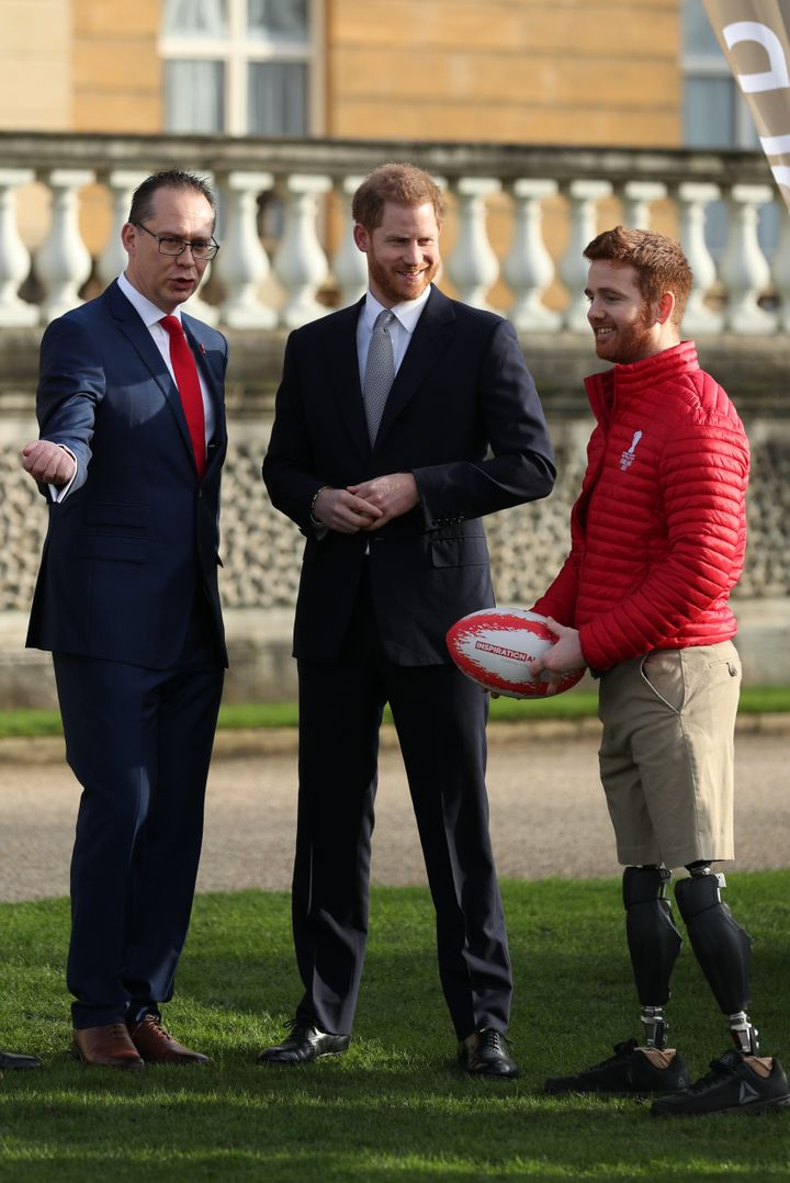 Rugby Prince Harry with Jon Dutton (left), chief executive of the Rugby League World Cup 2021, and Leeds Rhino player James Simpson