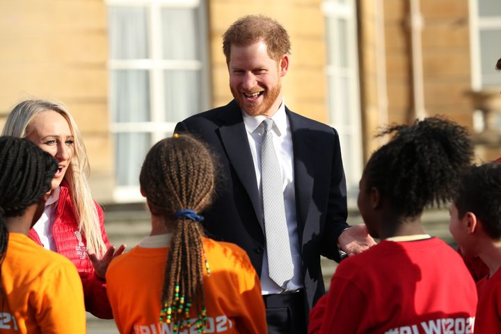 The Duke of Sussex visits with children playing rugby in the Buckingham Palace gardens, as he hosts the Rugby League World Cup 2021 draws on Jan. 16, 2020.
