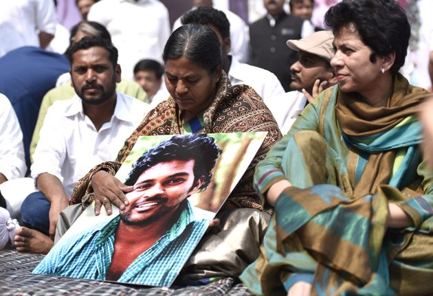 Radhika Vemula with her son's photograph at a protest at Jantar Mantar, New Delhi, on March 2,