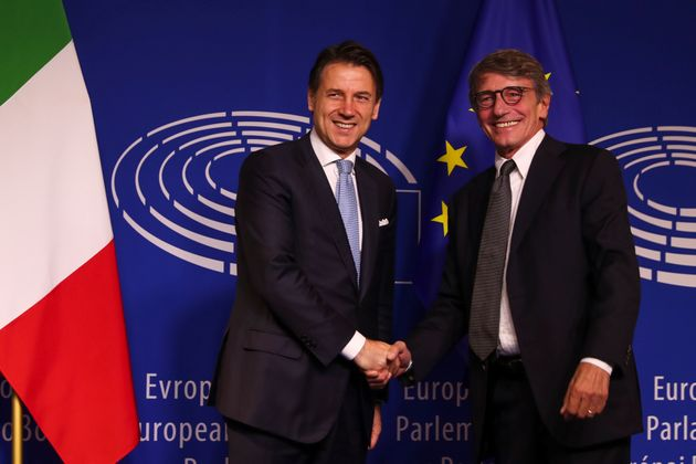 Italian Prime Minister Giuseppe Conte, left, shakes hands with President of the European Parliament David...