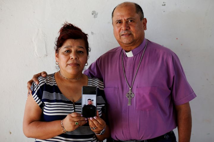 Rev. Irma de Alvarado and Bishop David Alvarado, of the Anglican Episcopal Church in El Salvador, show a picture of their son
